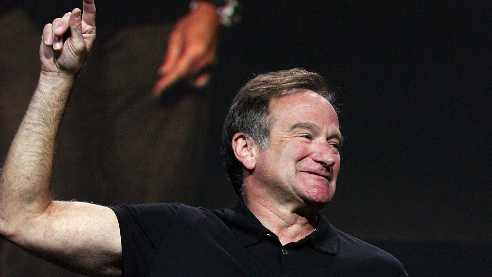 The famous Robin Williams shows his hand up wallpapers and image