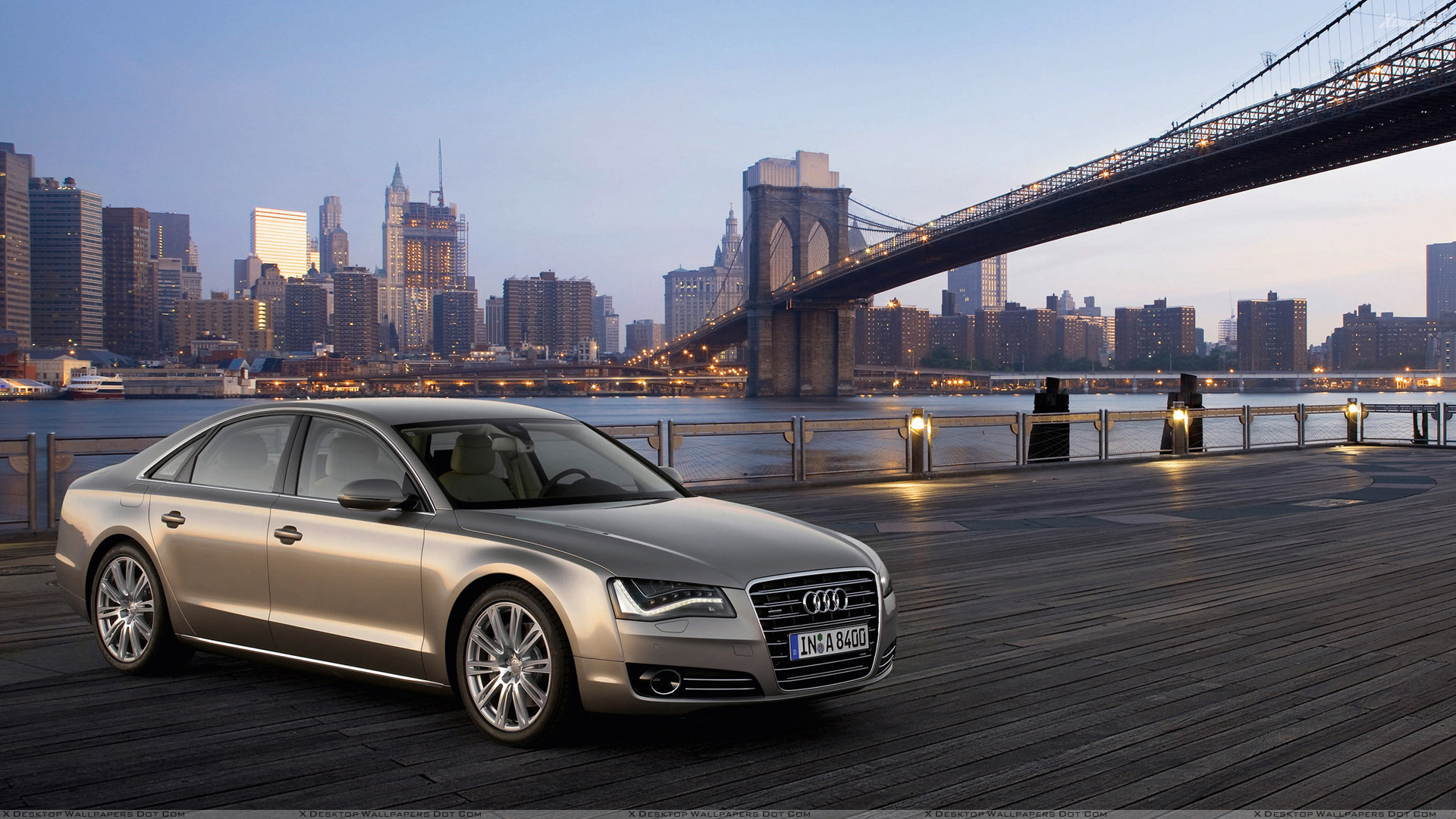 2011 Audi A8 Side Front Pose In Golden Wallpapers