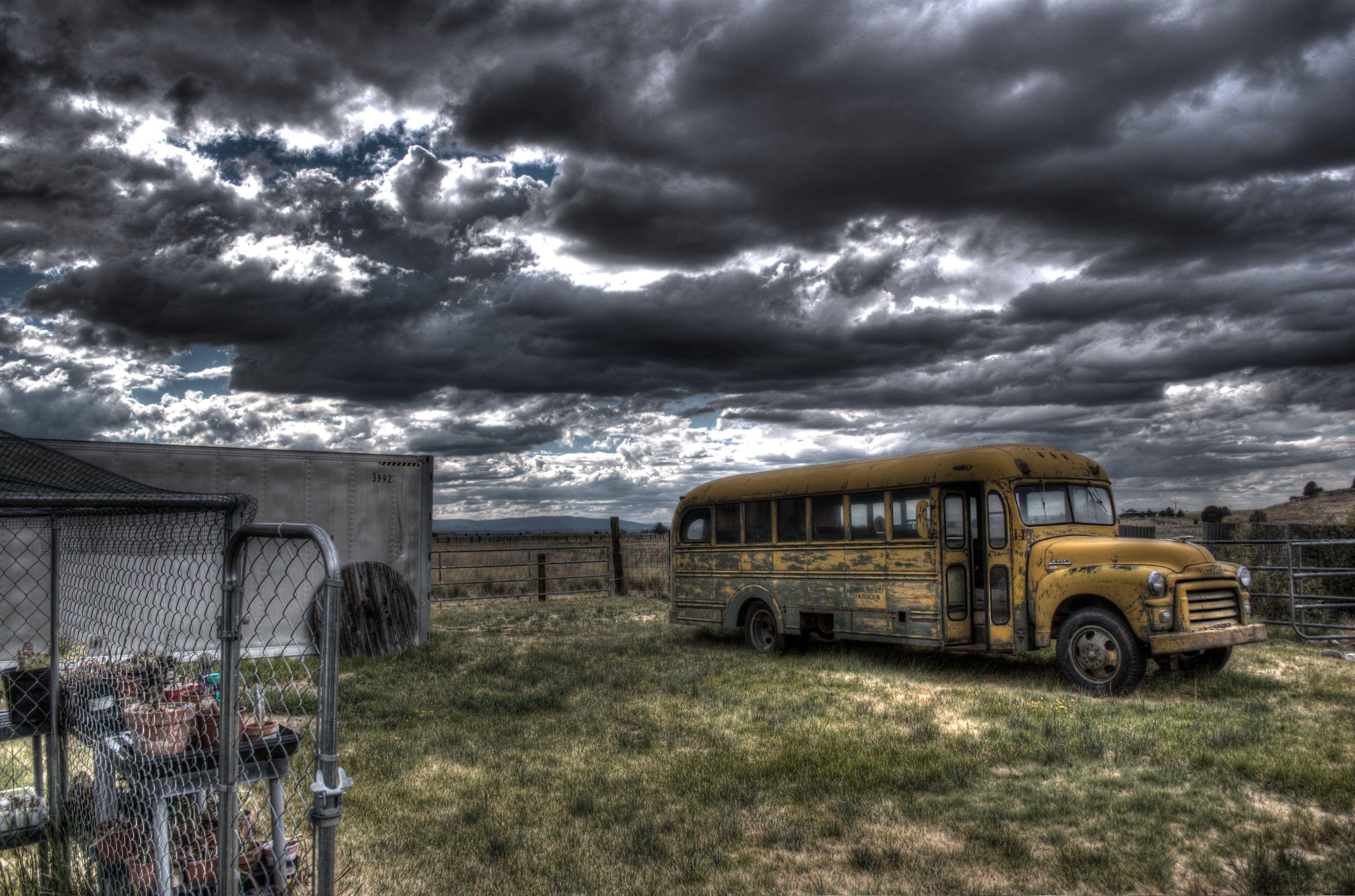Photography of school bus near fence HD wallpapers
