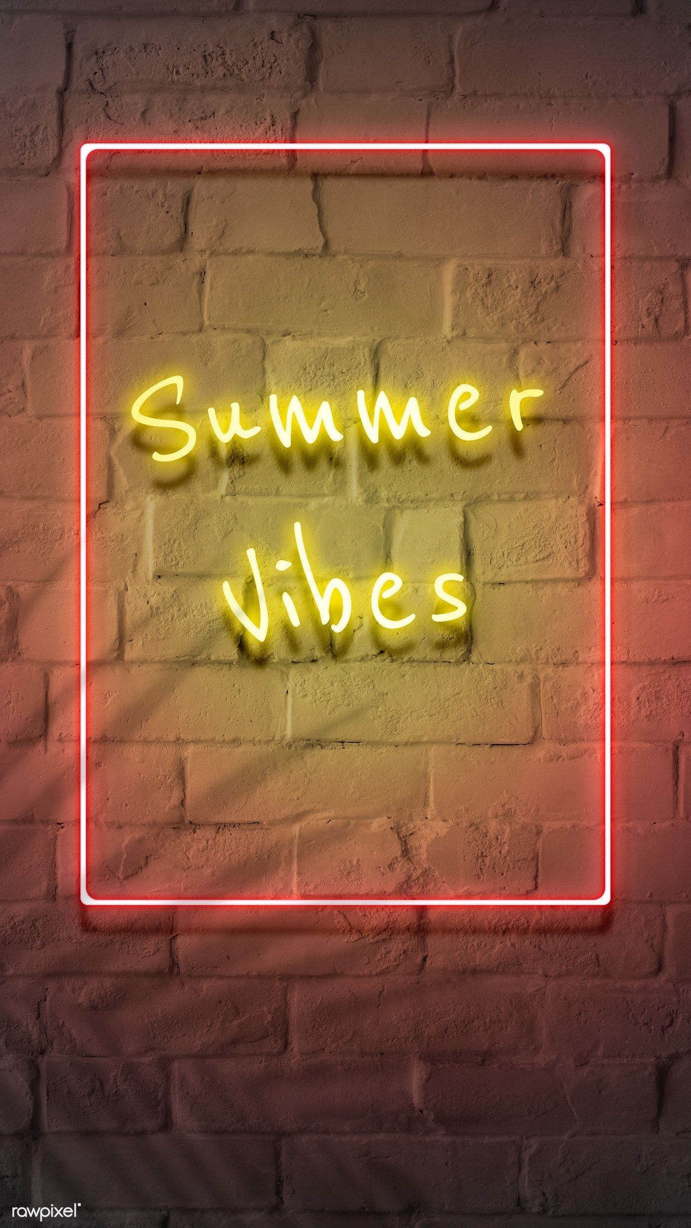 Neon yellow summer vibes in a frame on a brick wall